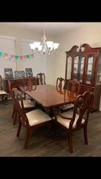 Dining table 8 chairs china cabinet and buffet Houston