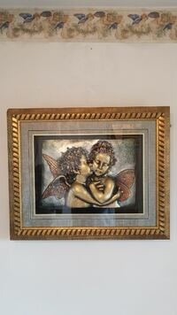 two angel artwork with square brown wooden frame Centreville, 20121