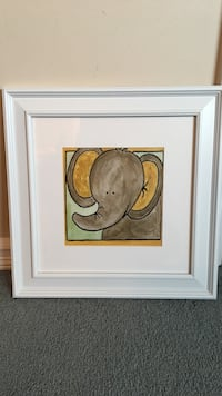 Brown elephant painting with white frame