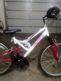 pink and white full-suspension bike Wrightstown