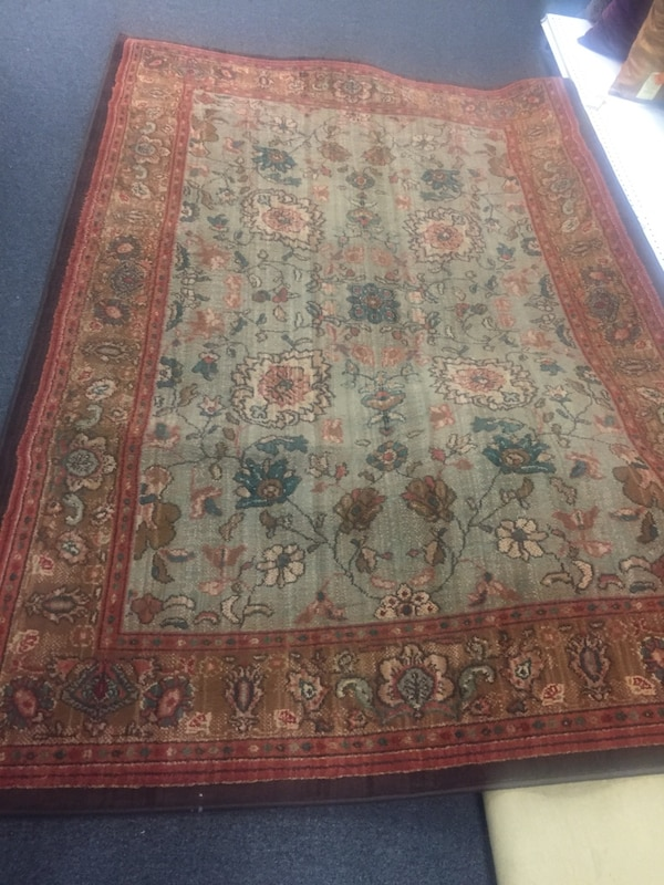 red, brown, and black floral area rug