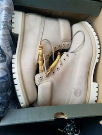 pair of white Timberland work boots in box
