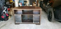 brown wooden framed glass top TV stand Plano, 75075