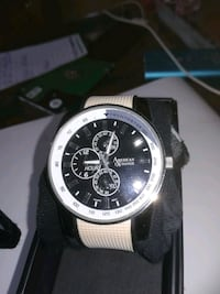round silver-colored chronograph watch with black  Montréal, H1J 1J4