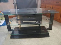 brown wooden framed glass top TV stand Toronto, M9W 3H3