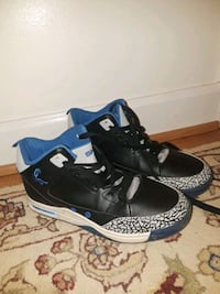 pair of black-and-blue high-top sneakers 56 km