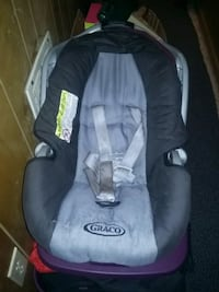 Baby's black and gray Graco car seat carrier