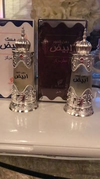 two glass perfume bottles with boxes Toronto, M9C 4W7