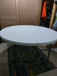 "NEW. 48"" round foldable plastic table $45.00"
