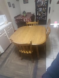 Solid wood table with 4 matching chairs