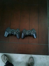 black Sony PS3 Super Slim with two controllers Edmonton, T5B 2L5