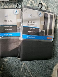 "2 pkgs of Black 38""Wx84""L curtains, brand new still in package."