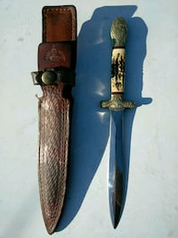 white handled dagger and brown leather sheath Dallas, 75243