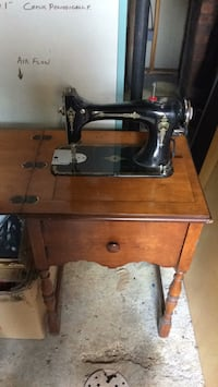 Antique sewing machine table by Graybar