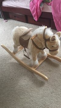 Ride on rocking horse with wooden bottom. Horse neighs shakes head and animates Gulf Shores, 36542