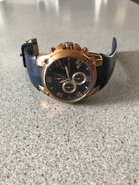 round gold-colored chronograph watch with black leather strap Chambly