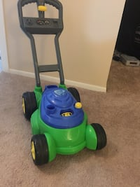 Green and blue  lawnmower toy Southfield, 48076