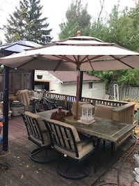 $450 patio marble table , 4 chairs and umbrella Hamilton, L9A 1T3