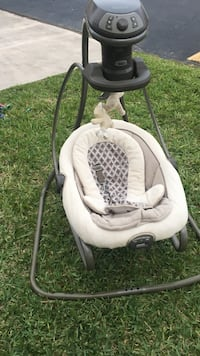 baby's white and gray cradle and swing Palmetto Bay, 33157