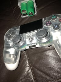 Silver and red Playstation controller Aldergrove, V4W 2M7