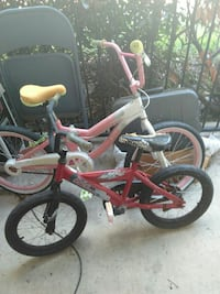 children's red and black BMX bicycle