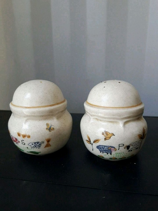two white-and-pink floral ceramic jars