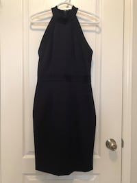 High collared navy dress.