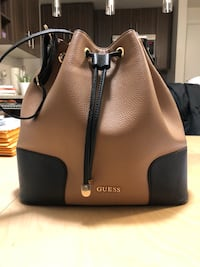 Genuine leather GUESS drawstring tote New Westminster, V3M 0G9