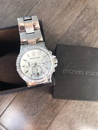 Round silver and michael kors watch with baguette diamonds Edmonton, T5P 4Y3