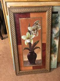 Black vase with white orchids painting with brown frame