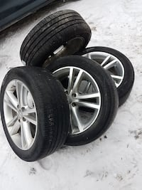 225 50 R18 dodge avenger or caliber rims and tires