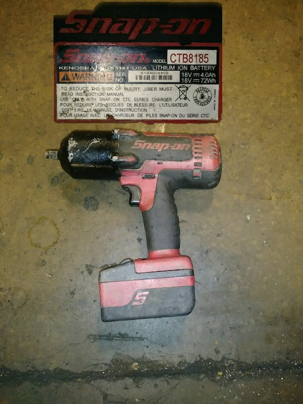 red and black cordless power drill