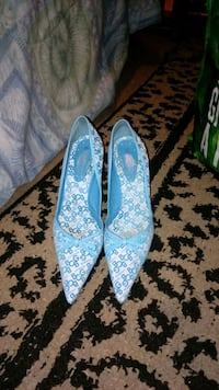 pair of blue and white floral flats