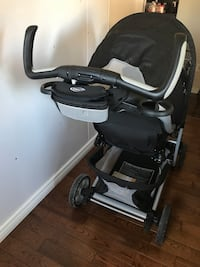 baby's black and gray stroller Laval, H7T 1V7