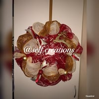 glittered red, white, and brown ribbon wreath