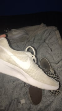 pair of white Nike running shoes Central Okanagan, V4T 1T1
