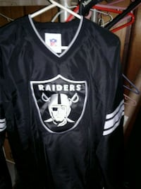 Brand new with tags NFL raiders pull over wind breaker