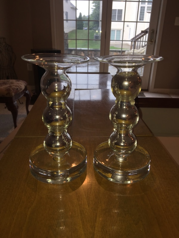Two clear glass candle holders