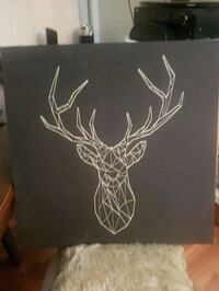 Print of a deer on black canvas