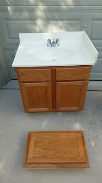 white ceramic vanity sink with stainless steel faucet and wooden base
