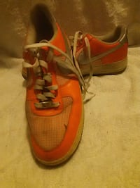 pair of red Nike running shoes Brooklyn, 11218