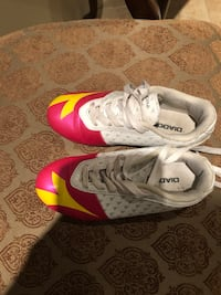 Pair of white-and pink outdoor Soccer shoes Cambridge, N1T 2J1