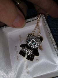 Gold necklace and panda pendant