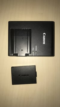 Cannon rebel battery pack and charger         2 batteries 3742 km