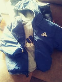 blue and white Adidas zip-up hoodie
