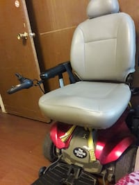 grey and red The Scooter Store motorized wheelchair