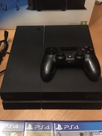 Black sony ps4 with dualshock 4 64 km