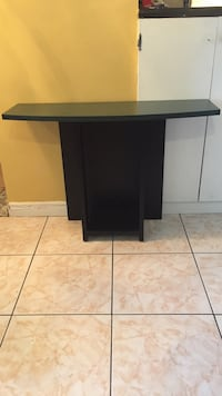 Black and green tv stand