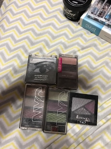 women's Rimmel and two NYC eyeshadow palettes