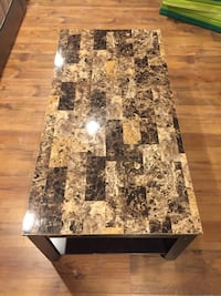 rectangular brown and black marble-top table 538 km